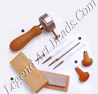 1 Engraver's vise adjustable hand-held vise which holds varying sizes of metal to be engraved:  2 four assorted gravers:  3 flat-sided handles;  4 Arkansas sharpening stone, which should be used with oil?