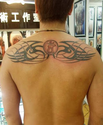 totem and sanskrit tattoo design on the back