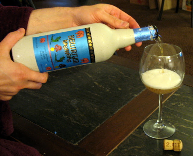 Pouring a bottle of Delirium Tremens Beer