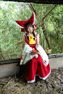 Saku Ayaka cosplay as Hakurei Reimu from Touhou Project