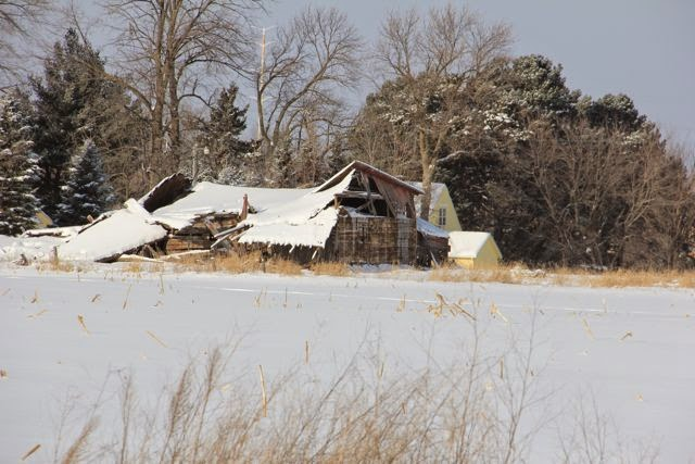 a collapsed barn