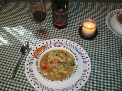 Dinner Table set with soup, wine, and candles