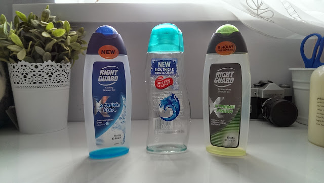 A picture of three empty shower gel bottles (right guard x 2 and imperial leather)