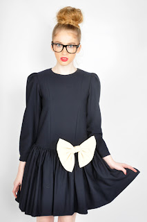 Vintage 1980's navy blue dolly dress with long sleeves and a large white bow on the front.