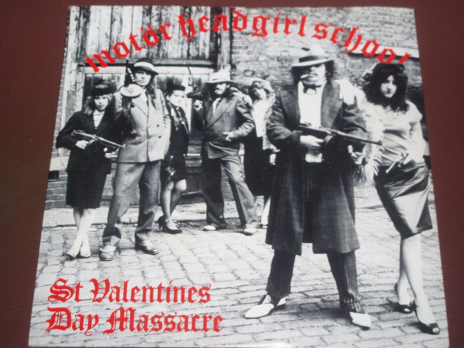 "saint valentines day massacre ""st christopher medals  the two thompson submachine guns used in the st valentine's day massacre are the ones on the far left and far right in this photo."