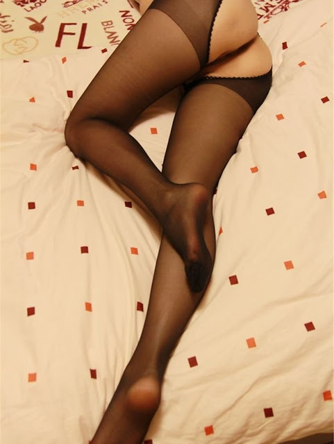 Asian Wife Showing Off Her Legs In Silk Stockings And Her