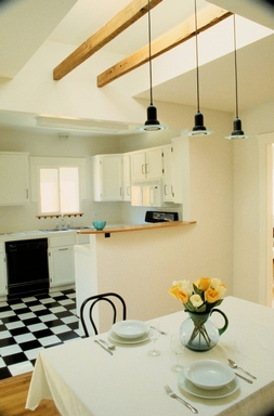 [An elegant kitchen with a checkerboard floor]