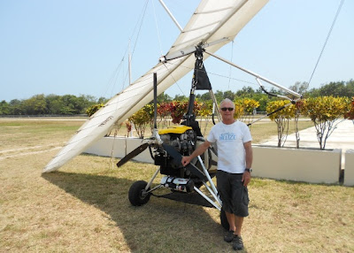 robert combs with his ultralight in placencia with mckinley pritchard