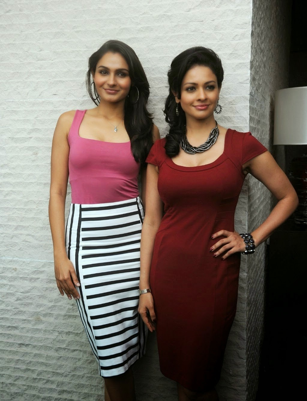 Andrea Jeremiah and Pooja Kumar Super Sexy Still From Tamil Film 'Uttama Villain' Press Meet
