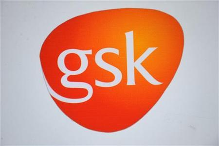 AGlaxoSmithKline logo is seen outside one of its buildings in west ...