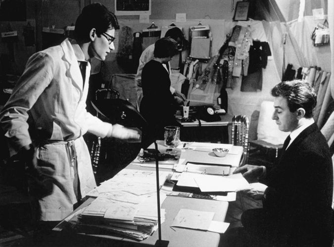 "Yves Saint Laurent and Pierre Berge at the rue Jean-Goujon in 1961 finalising the ""YSL"" photographed by Pierre Boulat"