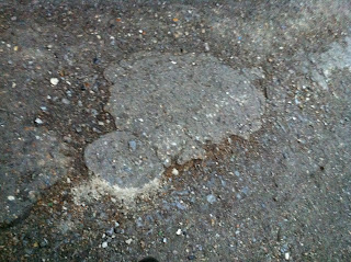 lumpy uneven paving that wheelchair wheels are prone to catching on and making you land on your chin #1