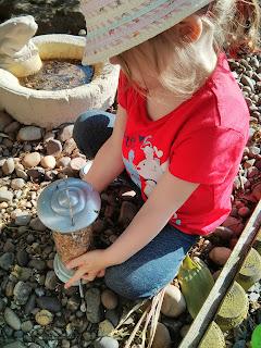 eldest refilling the bird feeders