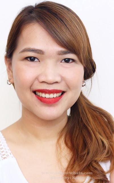 A photo of a girl wearing  Sleek True Colour Lipsticks in Russian Roulette