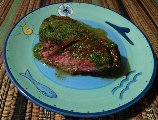 Lamb Chop on Plate Covered with Mint Sauce