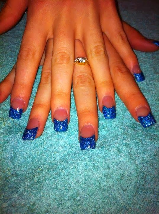 The custom blue glitz mix acrylic tips lovely pink fill and the trusty gel topcoat to complete
