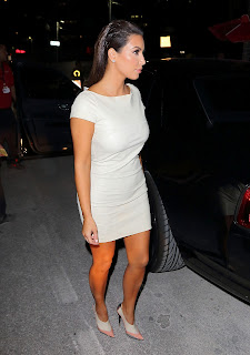 Kim Kardashian shows off her body figure in a leather mini dress