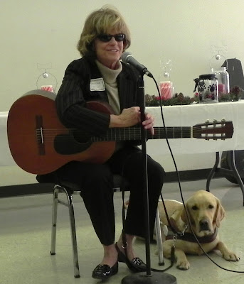 woman with guitar and yellow Lab