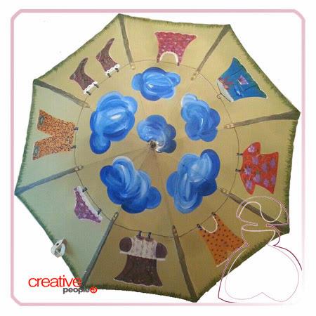 Paraguas pintado a mano modelo ropita tendida, realizado por Sylvia Lopez Morant.