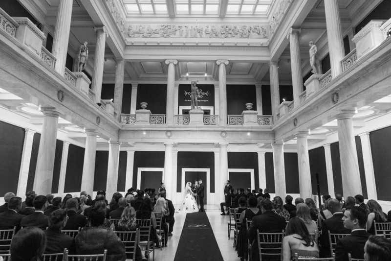 Carnegie Museum Wedding From Andrea, the bride: What was the inspiration for your Carnegie Museum Wedding? Is there anything that you did that you think makes your wedding particularly unique, alternative or different to the norm? We had a few different inspirations... I always wanted an evening cocktail themed wedding and we wanted to incorporate some of Seves' Spanish heritage. I think the most unique thing about our wedding is that we followed our own rules. We incorporated all the things that we as a couple enjoyed at other weddings we attended and left out the things we didn't. It was truly a day planned for us. I think too many weddings are planned for the guests instead of the couple. We chose a Friday evening wedding on Labor Day weekend so our guests could spend the rest of the holiday weekend with us and exploring Pittsburgh. How would you describe your wedding theme? Our wedding theme would be best described as an evening cocktail party with Spanish flare. Do you have any particularly significant, funny or important stories about something that happened surrounding your wedding? I don't think there is enough room in this article to list all of the funny stories surrounding our wedding... but to list a few.. I realized when we left the salon to head to the venue that I didn't have my wedding gown. At the time, I did not find it at all humorous but we laugh about it now. We had a large wedding party of 20 of our best friends so there were a lot of awkward, hilarious and occasionally inappropriate moments/videos created. It was the time of our lives spending the best day ever surrounded by them. Did you do any DIY projects? No.. they scare me. What was your favorite part of the wedding? Our favorite part of the wedding was seeing everything come together exactly the way we had envisioned it and spending the entire night with our closest friends and family celebrating. Photography: Steven Dray Images Venue: Carnegie Museum Flowers: Hepatica Hair & Makeup: Divinity Salon Dress: Maggie Sottero Cake: Parkhurst DJ: Anthony Griffith Band: The Satin Hearts