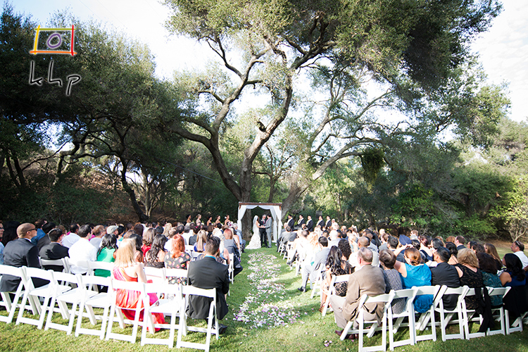 Under a huge tree in the vast backyard was the perfect location for this couple to wed.