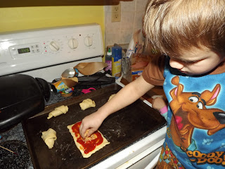 Making pizza rolls with Crescent Rolls