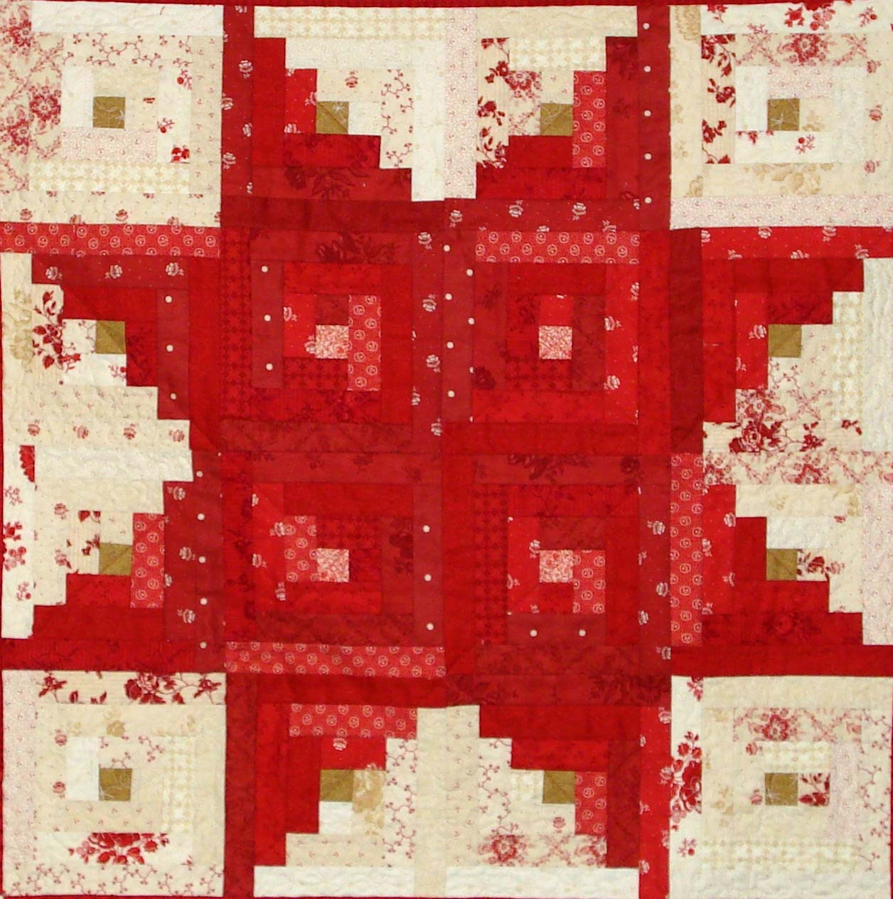 This is actually a quilt block the log cabin but i m using it to