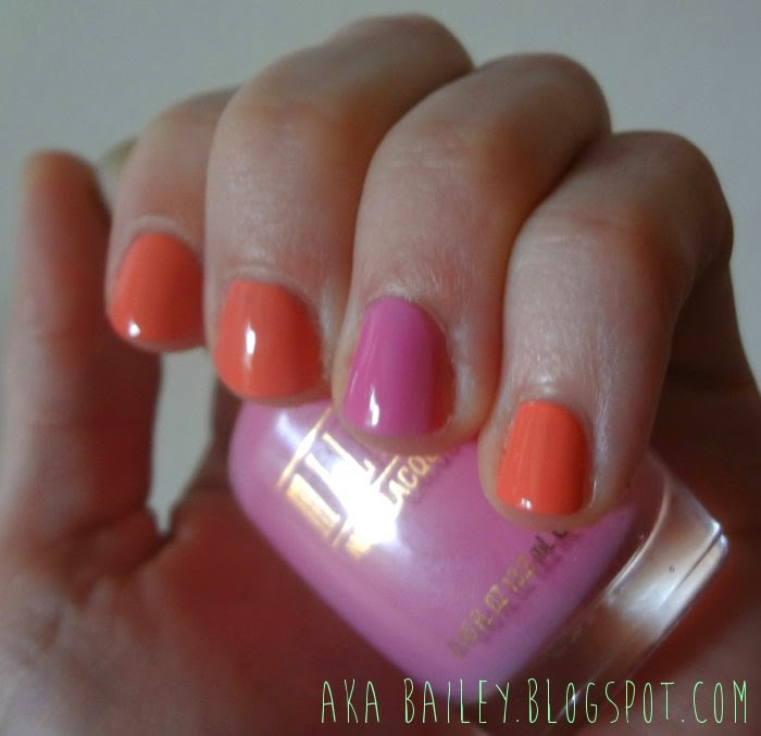 Coral nails with pink accent nail