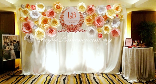 photo booth backdrop with giant paper flowers in pastel colours, bunting, logo, angelababy wedding, park royal hotel kuala lumpur, props, photo taking, ivory colour, elegant, simple, pretty, beautiful, bespoke, custom design, album table, love corner, reception table
