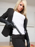 Secret agent girl in leather gloves with a gun