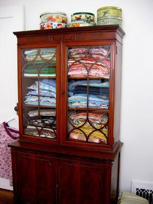 mylittlehousedesign.com vintage tins on top of cabinet