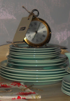 French Bradley clock sitting on top of Luray Surf Green China