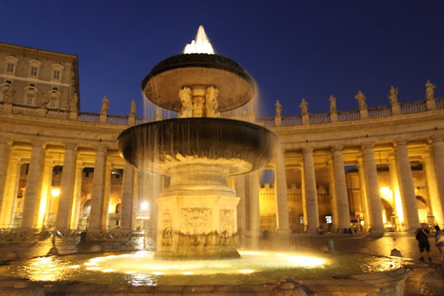 A close up look at the St Peter's fountain with Apostolic Palace at the background in Vatican City, Rome, Italy