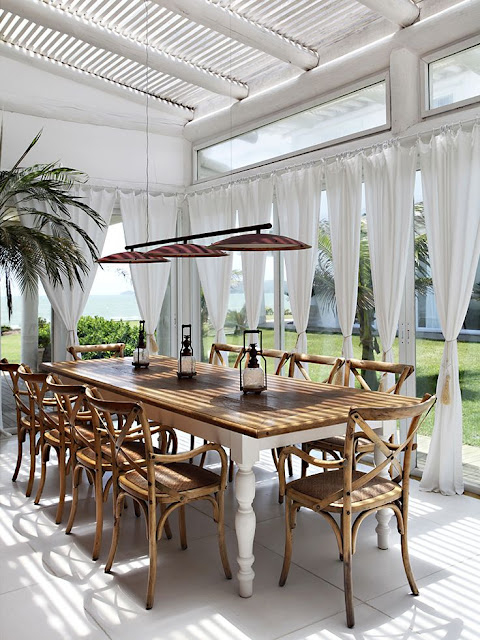 wicker dining table and chairs in colonial houses