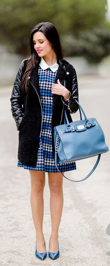 Black coat and blue metallic shoes