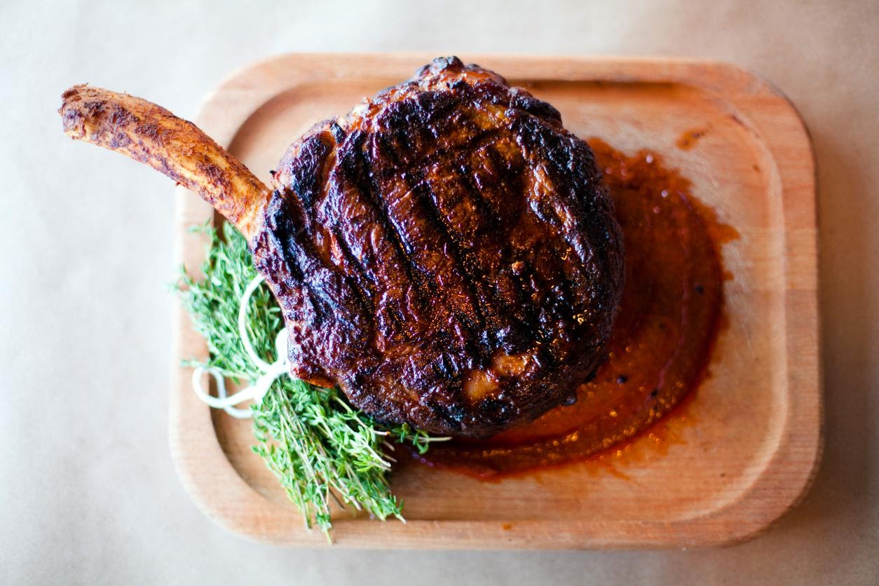 A pork porterhouse at the Ravenous Pig restaurant. Credit Jon Whittle