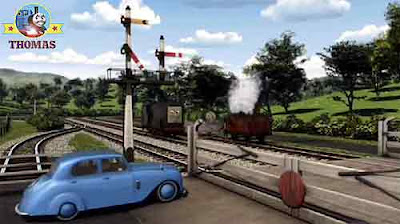 The Fat Controller arrived at the railway crossing gates opposite Diesel Percy the green locomotive