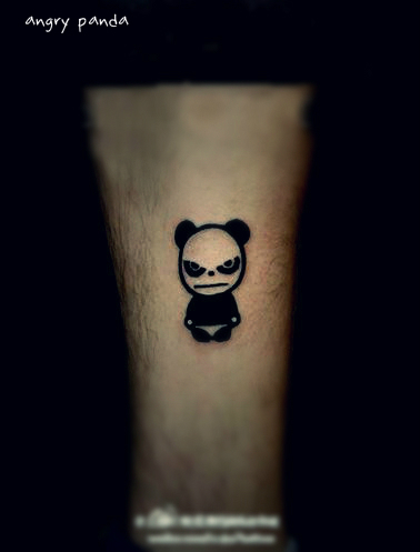 A kinda cute angry little panda tattoo on the leg