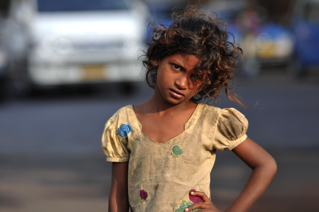 This is a photograph of street child in the Apollo Bandar area of Bombay in India.