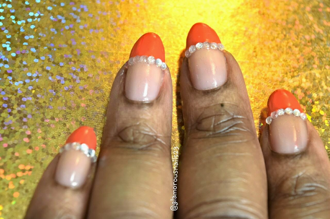 Orange French Tip Manicure with Studs