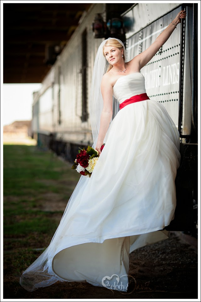 Bride hangs from the train on a windy day.