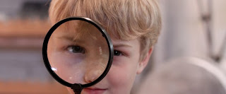Kid with a magnifying glass
