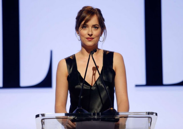 Dakota Johnson wears black to the Elle Women in Hollywood Awards