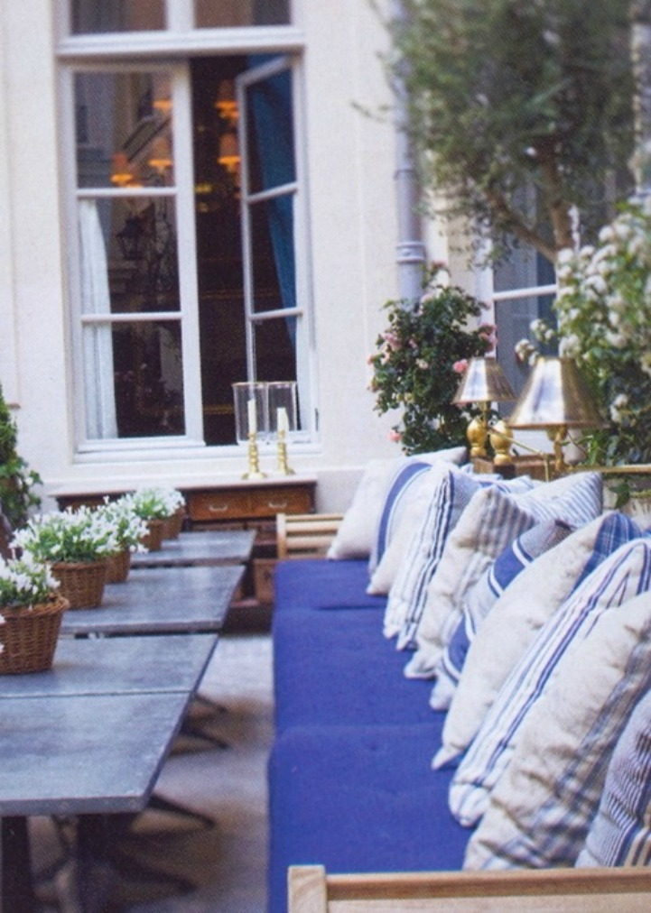 Coastal outdoor space with blue and white cushions