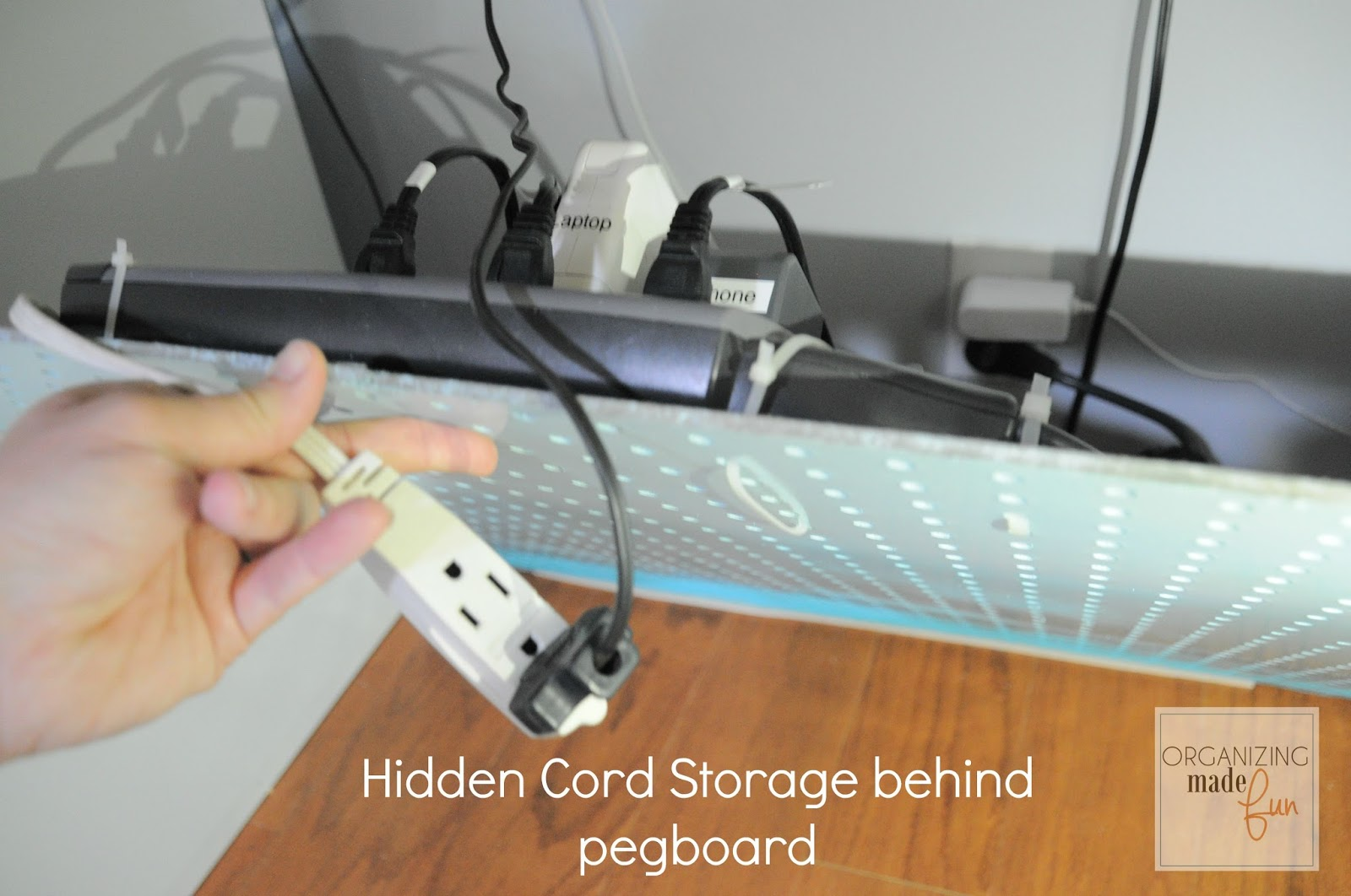 Under desk power strip hidden on back of pegboard :: OrganizingMadeFun.com
