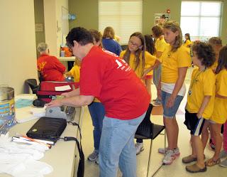 Laurel demonstrates braille at Bark Camp