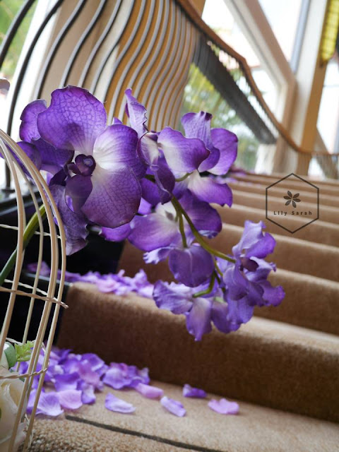 purple wedding staircase decoration by lily sarah