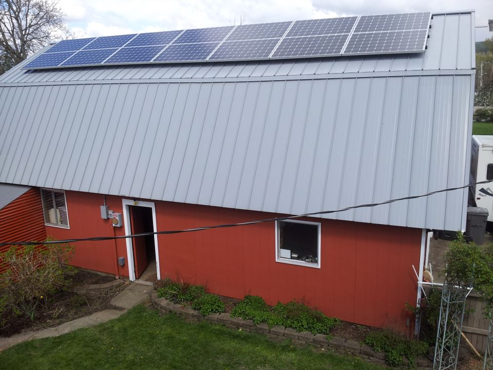 SOLAR PANELS:<br>CLICK ON THE PHOTO TO VIEW OUR REAL-TIME POWER GENERATION