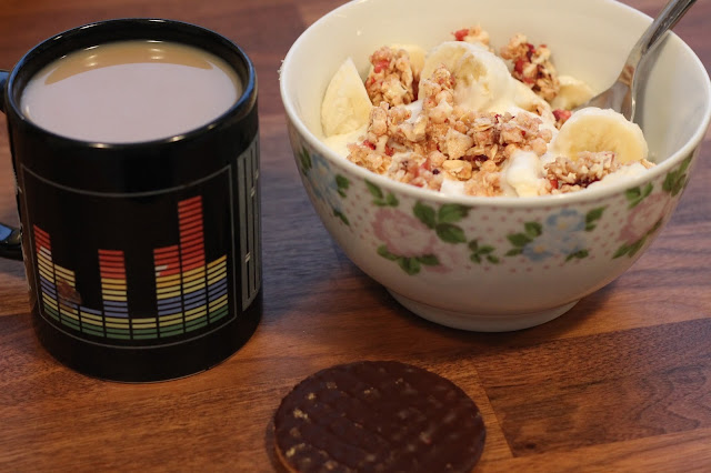 cup of coffee with slimming world banana and strawberry sundae and a chocolate digestive