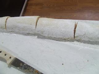 Cutting cinnamon rolls into fourths